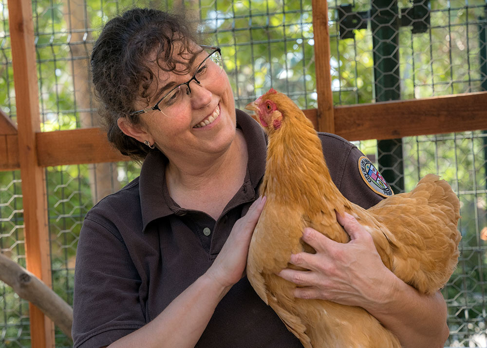 Keeper Barbara with Chickens JEP_3510
